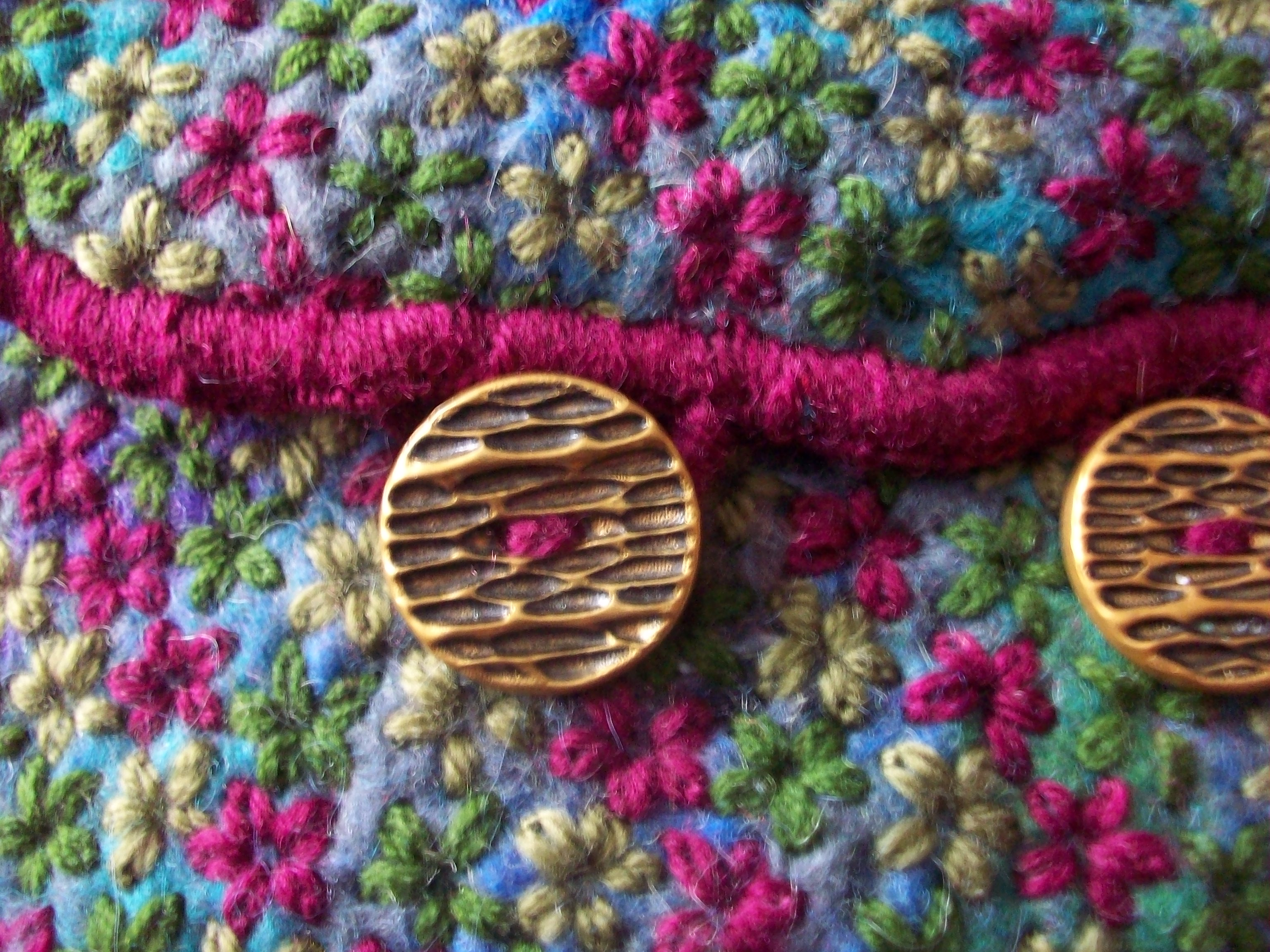 Each bag is finished with a blanket stitched edging and vintage buttons